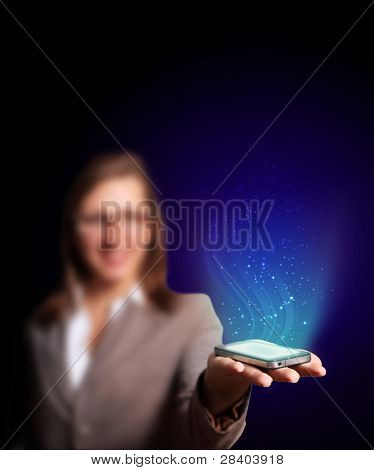 Business woman holding a mobile phone sending images