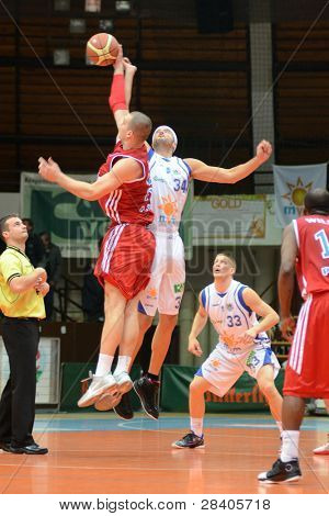 KAPOSVAR, HUNGARY - NOVEMBER 19: Michael Fey (white 34) in action at a Hugarian National Championship  basketball game Kaposvar (white) vs. Paks (red) November 19, 2011 in Kaposvar, Hungary.