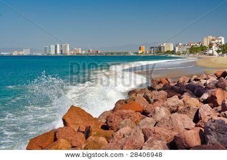 breaking wave on the beach in Puerto Vallarta, Mexico.