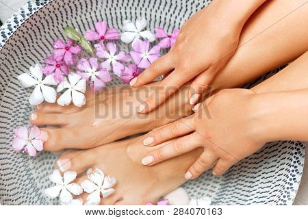 poster of Spa Treatment And Product For Female Feet And Foot Spa. Foot Bath In Bowl With Tropical Flowers, Tha