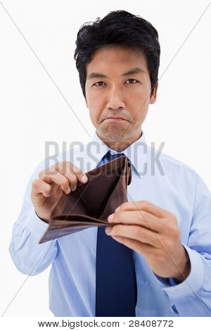 Portrait of a businessman showing his empty wallet against a white background