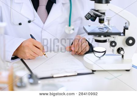 Close-up On Hands Of Medical Doctor Working At Office Table
