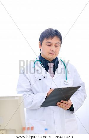 Medical Doctor Writing Something In Clipboard