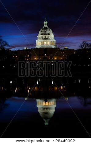 Washington DC, Unites States Capitol Building in early morning dusk with reflection on water