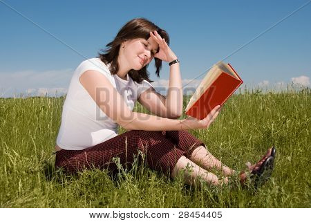 girl relaxing with a book outdoor