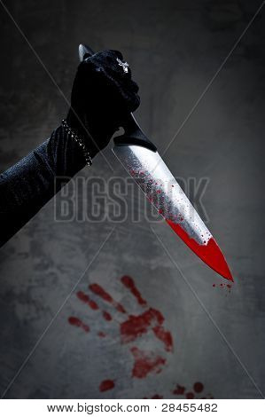 Female Hand With Bloody Knife