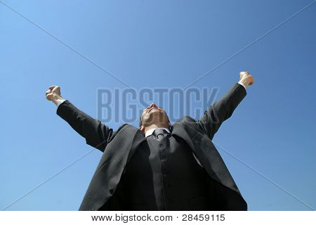 Sucess business man with arms wide open