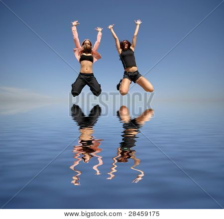 girls jumping to the water