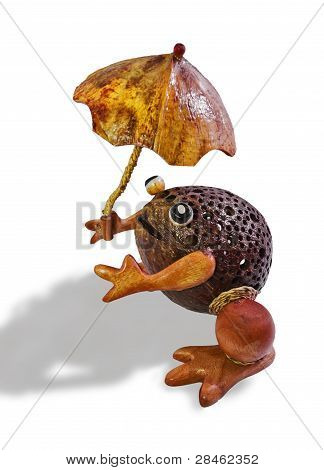 Toy In The Form Of A Toad With A Parasol Made ??from Whole Coconut. Close-up, Isolated