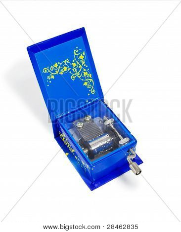Blue Music Box With The Lid Open And Bright Yellow Pattern. Isolated