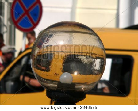 Streetlamp And Yellow Taxi Car