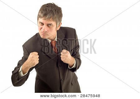 Angry businessman in aggressive boxing pose isolated on white background