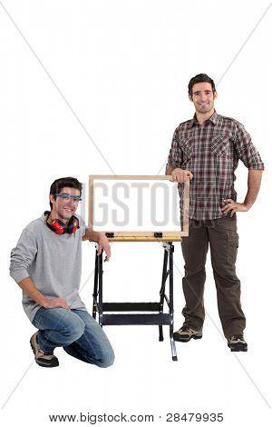 Cabinet maker and apprentice