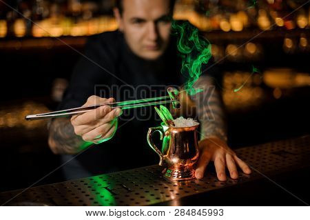 Man Adding To A Cocktail