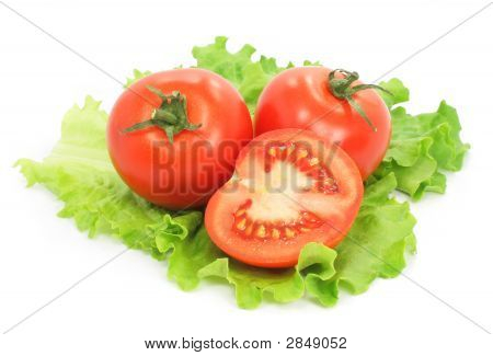 Fresh Tomatoes With Cut On Sheet Of Salad