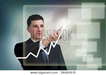 Businessman Poiting To Growth On A Graph