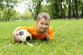 Little boy in the park with a ball