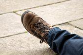 Hikers Boot On Stone Floor. Resting Pilgrim Boot On Obradoiro Square, Santiago De Compostela, Spain. poster