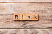 Risk Word Written On Wood Block. Risk Text On Wooden Table For Your Desing, Concept poster