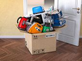 Home  kitchen appliances in open cardboard box. Delivery,  e-commerce and online shopping concept. M poster