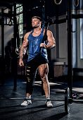 Professional Powerlifter With A Bandage On A Leg, Holding A Sports Hammer, Warming Up Before Trainin poster