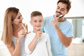 Happy Family With Toothbrushes In Bathroom. Personal Hygiene poster