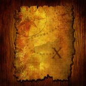 pic of treasure map  - Ancient treasure map on a wooden background - JPG