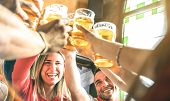 Friends Drinking And Toasting Beer At Brewery Bar Restaurant - Friendship Concept On Young Millenial poster