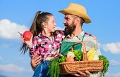 Only Organic And Fresh Harvest. Man Bearded Rustic Farmer With Kid. Father And Daughter Hold Basket  poster
