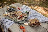 Delicious Composition On The Wooden Table Of The Smoke-dried Horse Mackerel And Anchovies On The Str poster