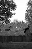 Old House And Fence With Electric Wires In Auschwitz Osventsim Concentration Camp - A Network Of Ger poster