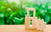 Wooden Padlock And Gear. Conceptual Strength And Security Mechanisms And Critical Nodes. Protection  poster