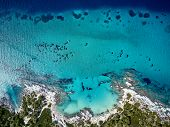Beautiful beach and rocky coastline top aerial view drone shot, Sithonia, Greece poster