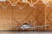 Passenger Aircraft On Maintenance. Aircraft Parcked In Hangar. Aircraft During Maintenance. Woden Ha poster