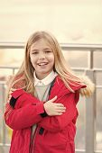 Kid With Arms Crossed Smile On Blurred Environment. Girl With Blond Long Hair On Autumn Day Outdoor. poster