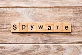 Spyware Word Written On Wood Block. Spyware Text On Wooden Table For Your Desing, Concept poster