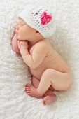 foto of newborn baby  - Newborn baby girl asleep on a blanket - JPG