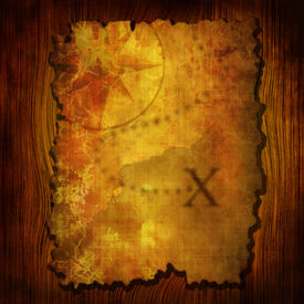 foto of treasure map  - Ancient treasure map on a wooden background - JPG