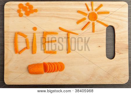 Diet Concept. Design Food. Word  Diet Carrots On A Cutting Board