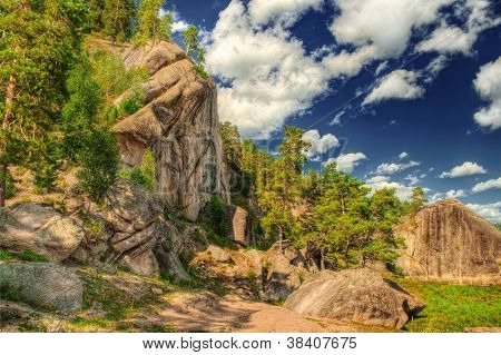 The Hdr Image Of Rocks With Pain Forest And Blue Sky.
