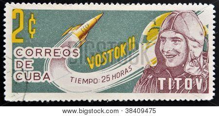CUBA - CIRCA 1963: A stamp printed in Cuba shows Titov and rocket Vostok 2 circa 1963
