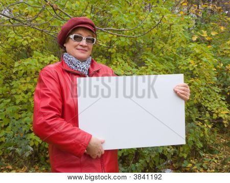 Lady In Red Holds An Empty Poster