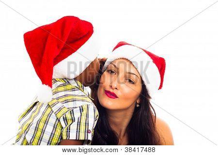 Beautiful Christmas Woman And Boy Whispering