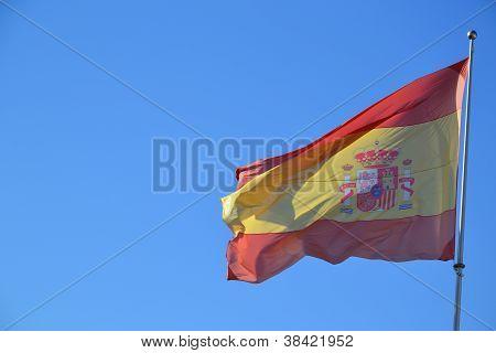 Spanish flag against clear blue sky