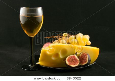 Wine, Cheese And Fruits On A Black Background
