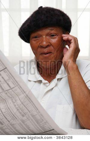 Surprised Newspaper Reader