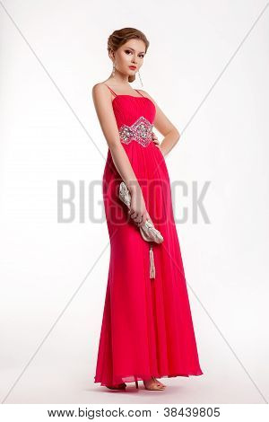 Trendy Stylish Fashion Model In Long Red Dress Posing