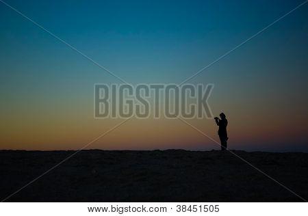 Tourist over Saint Vicent cliifs, Portugal