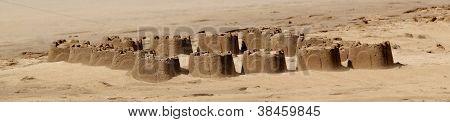 Small sandcastles on beach sand