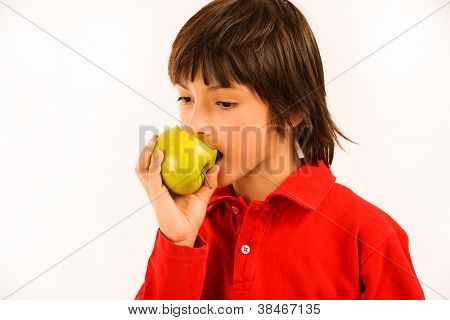 Boy Eating A Green Apple Isolated On White Background